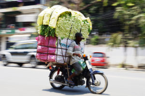 Cambodian Moto Dup delivering groceries