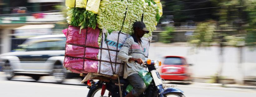 Cambodian Moto Dup delivering groceries