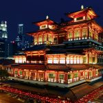 Burning Incense at the Buddha Tooth Relic Temple in Singapore